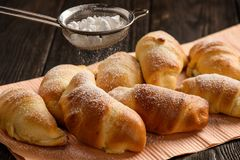 Homemade sweet croissants stuffed with cheese. Stock Photo