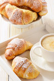 Homemade sweet croissants stuffed with cheese on white table. Royalty Free Stock Image