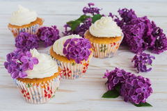 Homemade sweet cupcake with cream and flowers Royalty Free Stock Images
