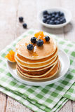 Homemade sweet pancakes with blueberries, fruit jam and honey Royalty Free Stock Image