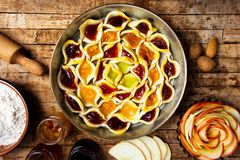 Homemade sweet pie with various fruit jams royalty free stock image