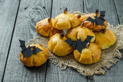 Homemade sweet pumpkin buns for Halloween Royalty Free Stock Photo