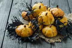 Homemade sweet pumpkin buns for Halloween Stock Image