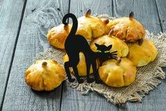 Homemade sweet pumpkin buns for Halloween Royalty Free Stock Photography