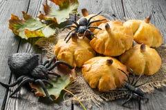 Homemade sweet pumpkin buns for Halloween Stock Photo