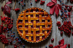Homemade sweet raspberry pie on vintage wooden table background. Rustic style autumn composition decoration. Royalty Free Stock Photography