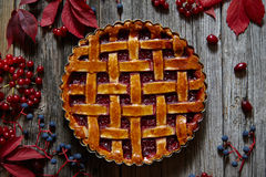 Homemade sweet raspberry pie on vintage wooden table background. Rustic style. Autumn composition. Stock Photography