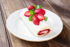 Homemade Sweet roll with Strawberry jam and berries Royalty Free Stock Photo