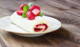 Homemade Sweet roll with Strawberry jam and berries Stock Images