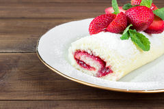 Homemade Sweet roll with Strawberry jam and berries Stock Image