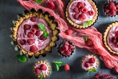 Homemade and sweet tarts with raspberries and mascarpone Royalty Free Stock Photo