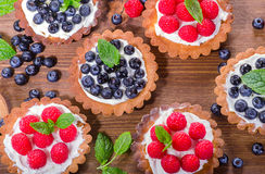 Free Homemade Sweet Tarts With Berries On A Wooden Table. Stock Images - 96380654
