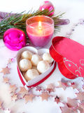 Homemade sweets in a box. Homemade sweets covered with coconut flakes are lying in the heart-shaped box stock image