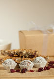 Homemade sweets. Composition: truffles with cranberries and granola bars in the background Stock Photo