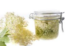 Homemade syrup from black elder - herb sambucus nigra Royalty Free Stock Photography