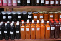 Homemade syrups, juices, and fruit Royalty Free Stock Image