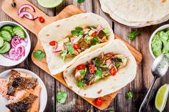 Homemade tacos with salmon royalty free stock images