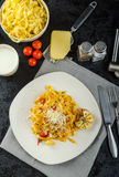 Homemade tagliatelle with garlic and cherry tomatoes Stock Photography
