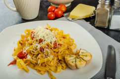 Homemade tagliatelle with garlic and cherry tomatoes Royalty Free Stock Photography