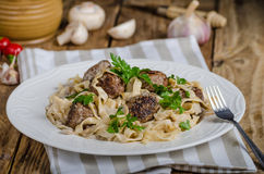 Homemade tagliatelle with meat balls Stock Photos