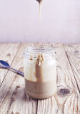Homemade tahini sauce in jar Royalty Free Stock Image