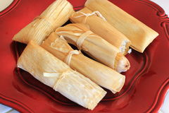 Homemade tamales on a red plate. Tamales  a typical dish for the holiday season in Mexico Royalty Free Stock Image