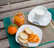Homemade tangerine marmalade on the small square dessert plate Stock Photos