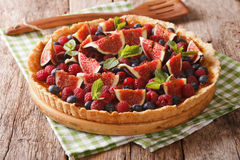 Homemade tart with fresh fruits and berries close up on the tabl Royalty Free Stock Photo