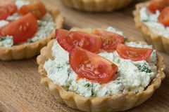 Homemade tartlet with feta, spinach and cherry tomatoes Stock Photography