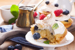Homemade tartlets with lime curd and meringue Stock Photo