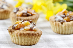Homemade tarts with dried fruits on checked table cloth Royalty Free Stock Images