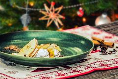 Homemade tasty christmas delicacy with apples and cinnamon.  Royalty Free Stock Photo