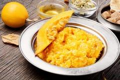 Pumpkin porridge and pumpkins. Homemade tasty porridge with orange pumpkin on rustic background royalty free stock images