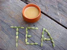 Homemade tea with cardamom word. On wooden board royalty free stock images