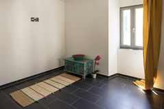 Homemade temple composed of a narrow rug and a small cabinet. To meditate stock photo