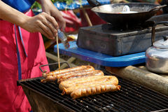 Homemade Thai food in grill. Thai sausage Northern style. Royalty Free Stock Photo