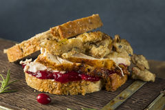 Homemade Thanksgiving Leftover Turkey Sandwich. With Stuffing and Cranberry Stock Photo