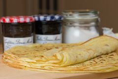 Homemade thin crepes for breakfast or dessert. The delicious french crepe.  stock photo