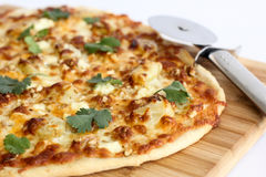 Homemade thin crust pizza. Homemade four cheese thin crust pizza royalty free stock photo