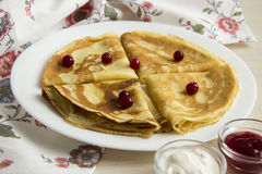 Homemade thin pancakes with jam. Many thin pancakes with jam on the table Stock Photo
