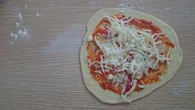Homemade thin pizza dough before bake Royalty Free Stock Photo