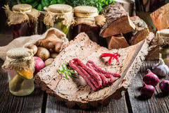 Homemade thin sausages in pantry Stock Photography
