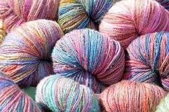 Homemade threads under sunshine in outdoor market Royalty Free Stock Images