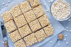 Homemade three ingredients bars with crispy rice, honey and peanut butter, horizontal, top view Stock Photography