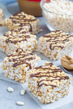 Homemade three ingredients bars: crispy rice, honey and peanut butter vertical Stock Photography