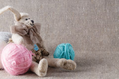 Homemade tilda doll and colored clew in backed Royalty Free Stock Photography