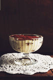 Homemade tiramisu in a glass placed on lace doily Stock Photography