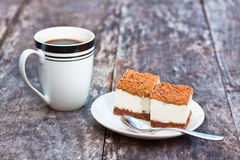 Homemade tiramisu  on the table with coffee mug Royalty Free Stock Photography