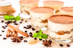 Homemade tiramisu, traditional Italian dessert in glass on wooden table Royalty Free Stock Photos
