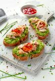 Homemade Toast sandwich with Salmon, Avocado and chilli jam on wihte wooden board. healthy food.  Stock Images